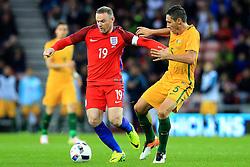 Wayne Rooney of England is challenged by Mark Milligan of Australia  - Mandatory by-line: Matt McNulty/JMP - 27/05/2016 - FOOTBALL - Stadium of Light - Sunderland, United Kingdom - England v Australia - International Friendly