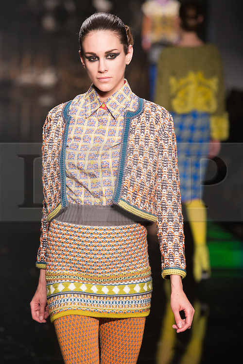 © Licensed to London News Pictures. 05/06/2013. London, England. A model walks down the catwalk during the Gala Show at Earl's Court 2. Graduate Fashion Week 2013 showcasing student collections took place at Earl's Court II from 2 to 5 June 2013. Photo credit: Bettina Strenske/LNP