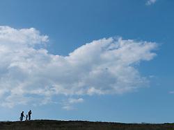 Family on hilltop