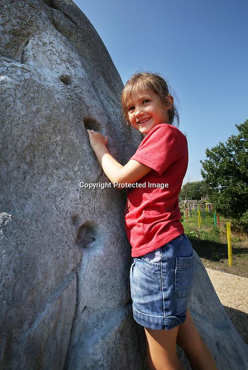 Children on the boldering rocks at Cuningar Loop woodland park.23.08.2015.Photo David Cheskin