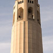 The top of Coit Tower, standing 210 feet, on top of Telegraph Hill in San Francisco, California. The tower was built in 1933 from funds bequeathed by Lillie Hitchcocl Coit.