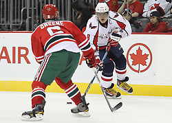 Mar 18; Newark, NJ, USA; Washington Capitals left wing Alex Ovechkin (8) skates with the puck while being defended by New Jersey Devils defenseman Andy Greene (6) during the third period at the Prudential Center. The Washington Capitals defeated the New Jersey Devils 3-0.