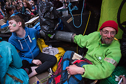 London, UK. 16th April 2019. Climate campaigners from Extinction Rebellion, some of whom locked onto or glued onto the Ship of Truth, occupy Oxford Circus on the second day of International Rebellion UK activities to call on the Government to take urgent action to address climate change.