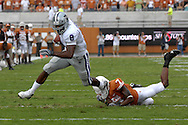 September 29, 2007 - Austin, TX..Running back James Johnson #8 of the Kansas State Wildcats rushes past defensive back Deon Beasley #7 of the Texas Longhorns in the first quarter, during a NCAA football game at Darrell Royal-Texas Memorial Stadium on September 29, 2007...FBC:  The Wildcats defeated the Longhorn 41-21.  .Photo by Peter G. Aiken/Cal Sport Media