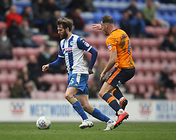 Dan Gardner of Oldham Athletic (R) and Nick Powell of Wigan Athletic in action - Mandatory by-line: Jack Phillips/JMP - 30/03/2018 - FOOTBALL - DW Stadium - Wigan, England - Wigan Athletic v Oldham Athletic - Football League One