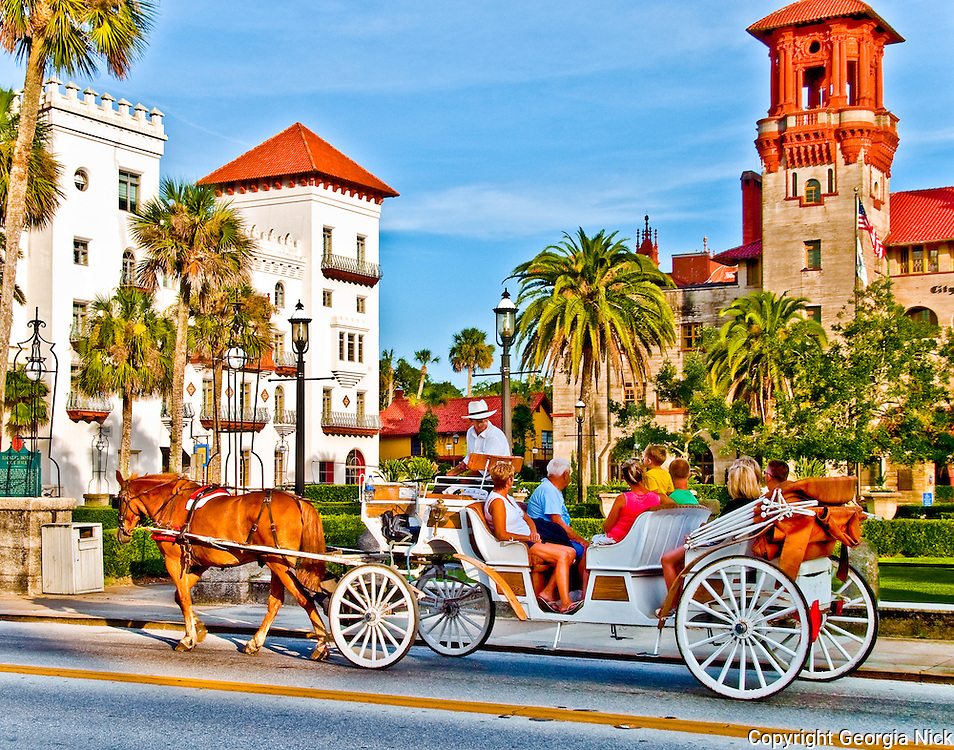 A horse and carriage in front of the St. Augustine City Hall/Lightner Museum and the Casa Monica Hotel in downtown St. Augustine, Florida. St. Augustine is the Nation's Oldest City.