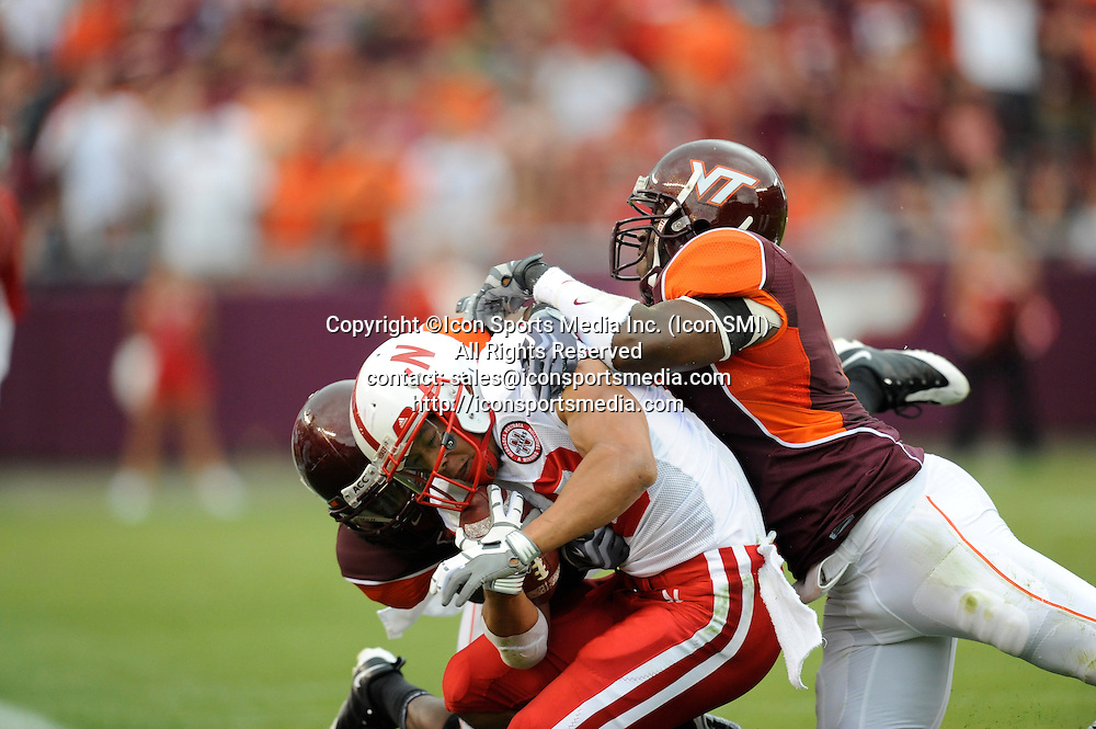 19 September 2009: Nebraska running back Roy Helu Jr. (10) and Virginia Tech linebacker Cody Grimm (26) during the Hokies 16-15 win over the Nebraska Huskers at Worsham Field at Lane Stadium in Blacksburg, VA