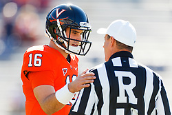 Oct 15, 2011; Charlottesville VA, USA;  Virginia Cavaliers quarterback Michael Rocco (16) talks to NCAA referee David Epperley before the game against the Georgia Tech Yellow Jackets at Scott Stadium.  Mandatory Credit: Jason O. Watson-US PRESSWIRE