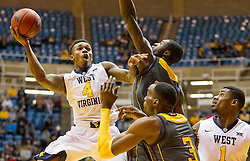 Nov 23, 2015; Morgantown, WV, USA; West Virginia Mountaineers guard Daxter Miles Jr. shoots in the lane during the first half against the Bethune-Cookman Wildcats at WVU Coliseum. Mandatory Credit: Ben Queen-USA TODAY Sports