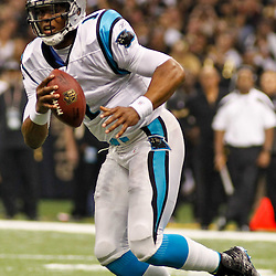 January 1, 2012; New Orleans, LA, USA; Carolina Panthers quarterback Cam Newton (1) looks to throw against the Carolina Panthers during the first quarter of a game at the Mercedes-Benz Superdome. The Saints defeated the Panthers 45-17.  Mandatory Credit: Derick E. Hingle-US PRESSWIRE