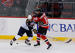 Nov 1, 2008; Newark, NJ, USA; New Jersey Devils right wing Jamie Langenbrunner (15) hits Atlanta Thrashers defenseman Nathan Oystrick (7) during the third period at the Prudential Center. The Devils defeated the Thrashers 6-1.