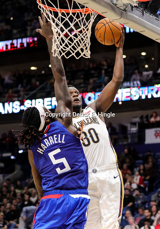 Oct 23, 2018; New Orleans, LA, USA; New Orleans Pelicans forward Julius Randle (30) shoots over Los Angeles Clippers forward Montrezl Harrell (5) during the second half at the Smoothie King Center. The Pelicans defeated the Clippers 116-109. Mandatory Credit: Derick E. Hingle-USA TODAY Sports