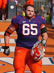November 21, 2009; Clemson, SC, USA;  Clemson Tigers guard Thomas Austin (65) on the hill before the game against the Virginia Cavaliers at Memorial Stadium.  Clemson defeated Virginia 34-21.