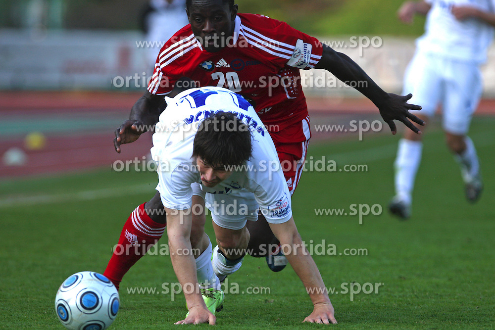 Etien Velikonja  of Hit Gorica and Theophile Ntame of Interblock at 28th Round of Slovenian First League football match between NK Interblock and ND Hit Gorica ZAK Stadium, on April 11, 2009, in Ljubljana, Slovenia. Gorica won 2:1. (Photo by Vid Ponikvar / Sportida)