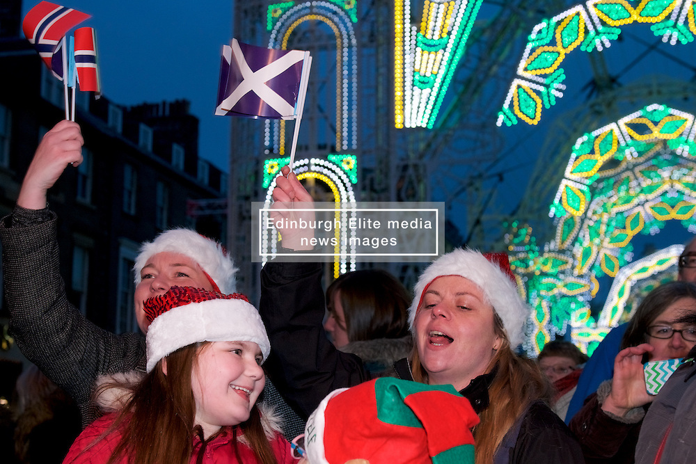 Family sing along at this years the Street of Light at the west end of George Street as part of Light Night and the acts will perform on a stage by its lights. Choirs from across Scotland including Edinburgh Festival Chorus, Royal Scottish National Orchestra Junior Chorus, Edinburgh's Got Soul and Edinburgh Rock Choir will perform in front of an expected audience of around 20,000 people.  The whole event is hosted by Forth One Arlene Stuart. Callum Skinner, gold cycling medallist will be the one pushed the button at 5pm. Sunday 20th November 2016 (c) Brian Anderson | Edinburgh Elite media