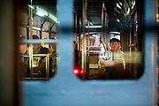 Hong Kong, China - A passenger looks out from a tram at night in Hong Kong on May 03, 2018.