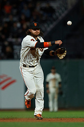 SAN FRANCISCO, CA - JUNE 12: Brandon Crawford #35 of the San Francisco Giants throws to first base against the San Diego Padres during the ninth inning at Oracle Park on June 12, 2019 in San Francisco, California. The San Francisco Giants defeated the San Diego Padres 4-2. (Photo by Jason O. Watson/Getty Images) *** Local Caption *** Brandon Crawford