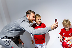 Nathan Baker as Mascots meet the players - Rogan/JMP - 30/11/2019 - Ashton Gate Stadium - Bristol, England - Bristol City v Huddersfield Town - Sky Bet Championship.