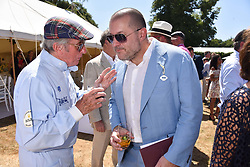 Sir Jackie Stewart and Sir Jonathan Ive at the 'Cartier Style et Luxe' enclosure during the Goodwood Festival of Speed, Goodwood House, West Sussex, England. 15 July 2018.