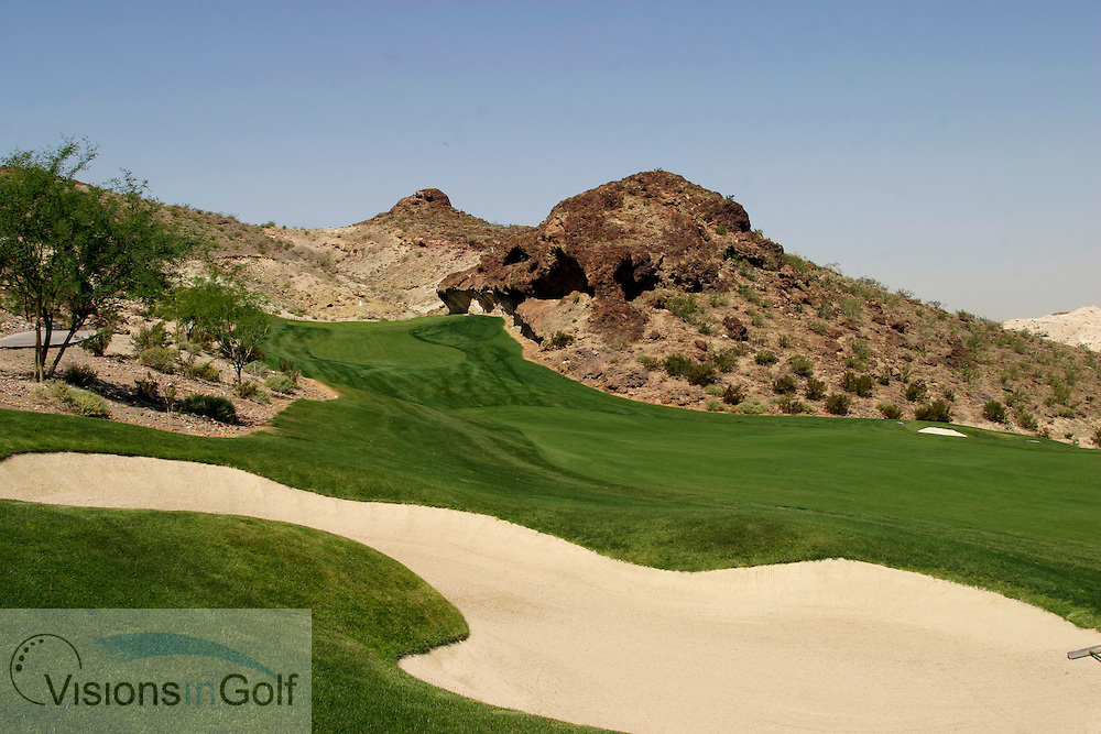 the view of the 2nd shot to the 13th at The Falls GC in Lake Las Vegas - a blind shot to a green hidden high behind the rock face middle picture  - a par 4 of 388yds<br /> Las vegas, NV, USA<br /> Photo Credit: Charles Briscoe-Knight / visionsIngolf.com