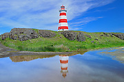 Reflection of Brier Island Lighthouse (also known as West Light or Southwest Light) in pond<br /> Brier Island on the Digby Neck<br /> Nova Scotia<br /> Canada