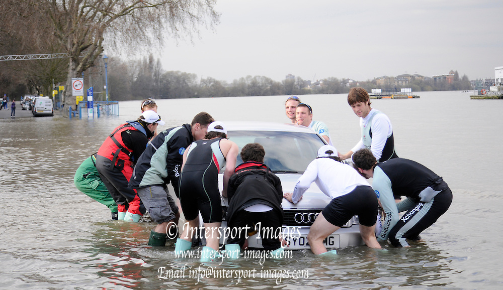 Putney. London. Tideway Week build up to the   2011 University Boat Race over parts of the Championship Course - Putney to Mortlake. Cambridge, CUBC, Goldie Crew, attempt to move a car, as the river floods the road, at the top of the tide. Monday  21/03/2011 [Mandatory Credit; Karon Phillips/Intersport-images].. 2011 Tideway Week