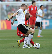 Bastian SCHWEINSTEIGER and Jermain DEFOE (re, England) during the 2010 World Cup Soccer match between England and Germany in a group 16 match played at the Freestate Stadium in Bloemfontein South Africa on 27 June 2010.