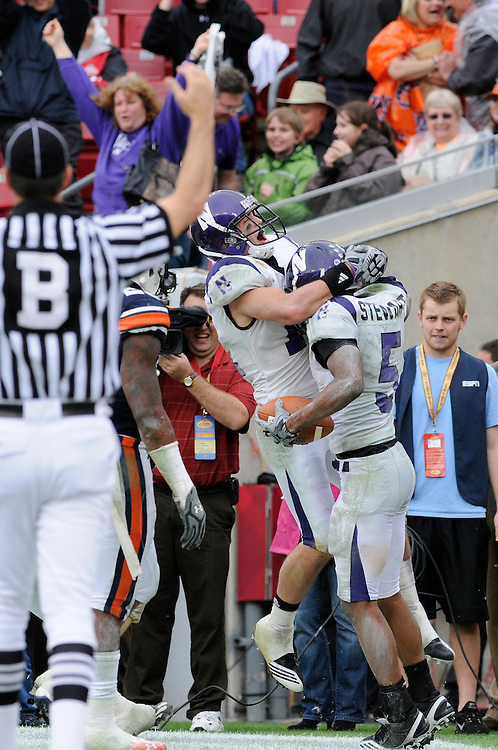 January 1, 2010: Wide receiver Jeremy Ebert of the Northwestern Wildcats celebrates with wide receiver Sidney Stewart ofter Stewart's touchdown during the NCAA football game between the Northwestern Wildcats and the Auburn Tigers in the Outback Bowl. The Tigers defeated the Wildcats 38-35 in overtime.