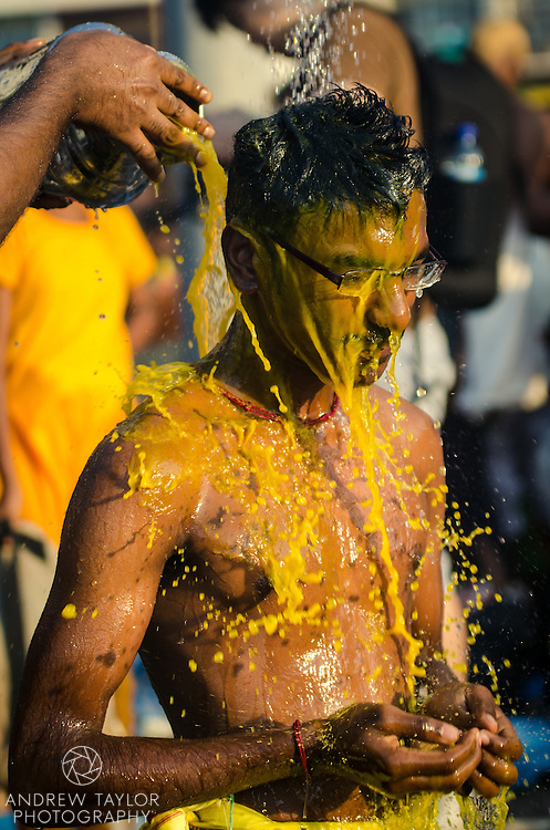 A devotee washes after participating in Thaipusam festival, Batu Caves, Kuala Lumpur, Malaysia