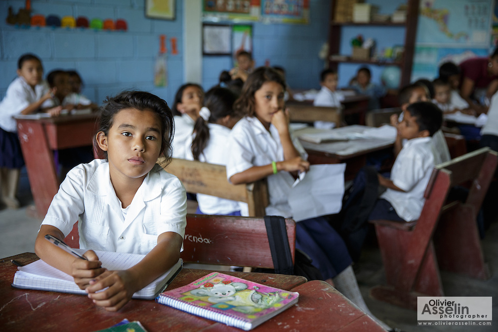 A girl writes in her notebook during class at the primary school in the town of Coyolito, Honduras on Wednesday April 24, 2013.