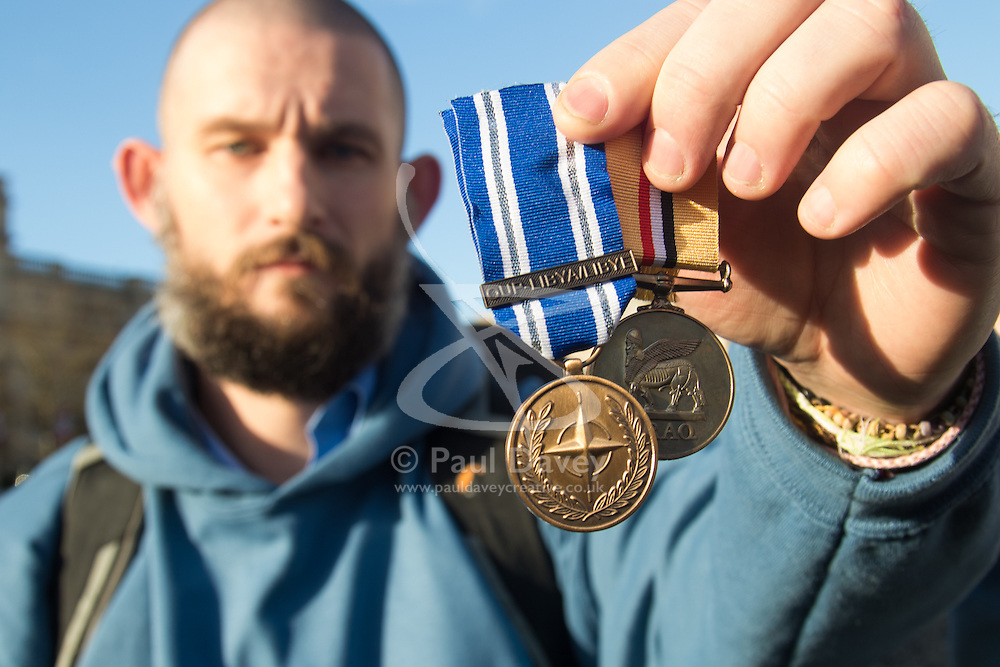 London, December 8th 2015. British War Veterans discard their medals in protest against the country's decision to join allies in bombing IS/Daesh in Syria. ///FOR LICENCING CONTACT: paul@pauldaveycreative.co.uk TEL:+44 (0) 7966 016 296 or +44 (0) 20 8969 6875. ©2015 Paul R Davey. All rights reserved.