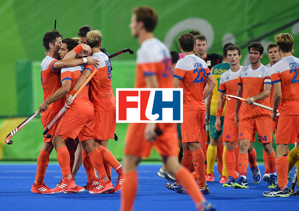 Netherland's players celebrateat the end of the men's quarterfinal field hockey Netherlands vs Australia match of the Rio 2016 Olympics Games at the Olympic Hockey Centre in Rio de Janeiro on August 14, 2016. / AFP / MANAN VATSYAYANA        (Photo credit should read MANAN VATSYAYANA/AFP/Getty Images)