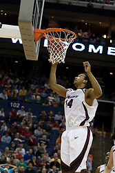Southern Illinois Salukis forward Randal Falker (14) watches a VT basket fall in the second half.  The #4 seed Southern Illinois Salukis defeated the #5 seed Virginia Tech Hokies 63-48 in the second round of the Men's NCAA Basketball Tournament at the Nationwide Arena in Columbus, OH on March 18, 2007.