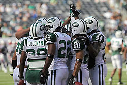 Sept 19, 2011; East Rutherford, NJ, USA; the New York Jets defense does a cheer during the pre-game warmup before their game against the New England Patriots at the New Meadowlands Stadium.