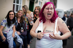 "© Licensed to London News Pictures . 30/05/2014 . Manchester , UK . LESLEY COUPS (38 from Bradford) shows her "" Donnie W "" NKOTB tattoo on her breast , in tribute to Donnie Wahlberg . New Kids on the Block fans outside pub round the corner from the Apollo Theatre , ahead of a NKOTB gig tonight (30th May 2014) . Photo credit : Joel Goodman/LNP"