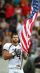10.07.2011, Tivoli Stadion, Innsbruck, AUT, American Football WM 2011, Group A, Germany (GER) vs United States of America (USA), im Bild Zach Watkins (USA, #44, LB) during the national anthem // during the American Football World Championship 2011 Group A game, Germany vs USA, at Tivoli Stadion, Innsbruck, 2011-07-10, EXPA Pictures © 2011, PhotoCredit: EXPA/ T. Haumer