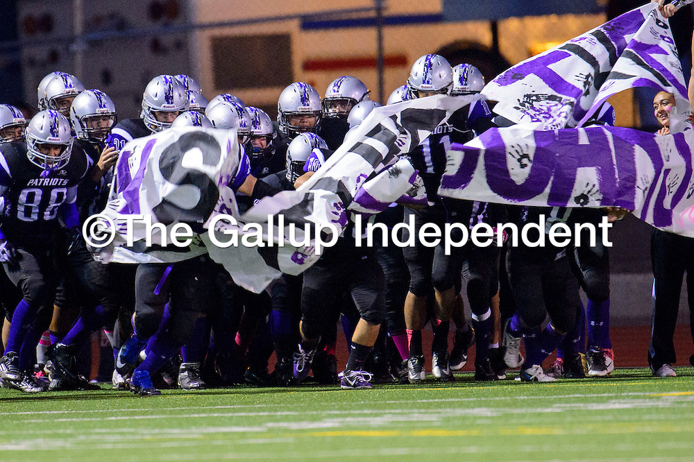 101813  Adron Gardner/Independent<br /> <br /> The Miyamura Patriots tear through a banner before taking on the Valencia Jaguars at Public School Stadium in Gallup Friday.