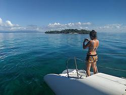 Tourist taking photos with smartphone. Caribbean sea near cayo Iguana, Cuba.