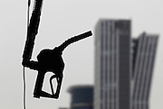 A gasoline pump is seen hanging at a petrol station in central Seoul. Photo by Lee Jae-Won (SOUTH KOREA) www.leejaewonpix.com/