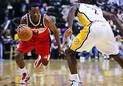 March 29, 2012; Indianapolis, IN, USA; Washington Wizards point guard John Wall (2) brings the ball up court against Indiana Pacers point guard Darren Collison (2) at Bankers Life Fieldhouse. Mandatory credit: Michael Hickey-US PRESSWIRE