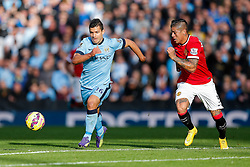 Sergio Aguero of Manchester City is challenged by Marcos Rojo of Manchester United - Photo mandatory by-line: Rogan Thomson/JMP - 07966 386802 - 02/11/2014 - SPORT - FOOTBALL - Manchester, England - Etihad Stadium - Manchester City v Manchester United - Barclays Premier League.