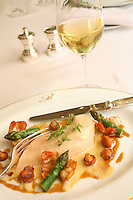 the plated breast of  Poulard de Bresse  en Vessie..with girolles (chanterelles), asparagus, and ecrevissses (crayfish)..served with a glass of Puligny Montrachet.. Hotel Bristol, Paris..Chef Eric Frechon.....photo by Owen Franken