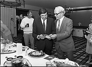 """The National Fish Cookery Award""..29.04.1982..04.29.1982.29th April 1982.1982..This competition sponsored by Bord Iascaigh Mhara was held in The Clare Inn, Newmarket-on Fergus,Co Clare. the competition was open to schools across the country.. The Minister for Fisheries and Forestry, Mr Brendan Daly and Mr T F Geoghegan, Market Development Manager, Bord Iascaigh Mhara, view the entries."