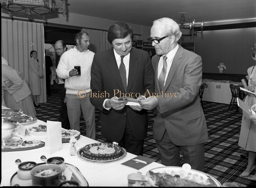 """""""The National Fish Cookery Award""""..29.04.1982..04.29.1982.29th April 1982.1982..This competition sponsored by Bord Iascaigh Mhara was held in The Clare Inn, Newmarket-on Fergus,Co Clare. the competition was open to schools across the country.. The Minister for Fisheries and Forestry, Mr Brendan Daly and Mr T F Geoghegan, Market Development Manager, Bord Iascaigh Mhara, view the entries."""