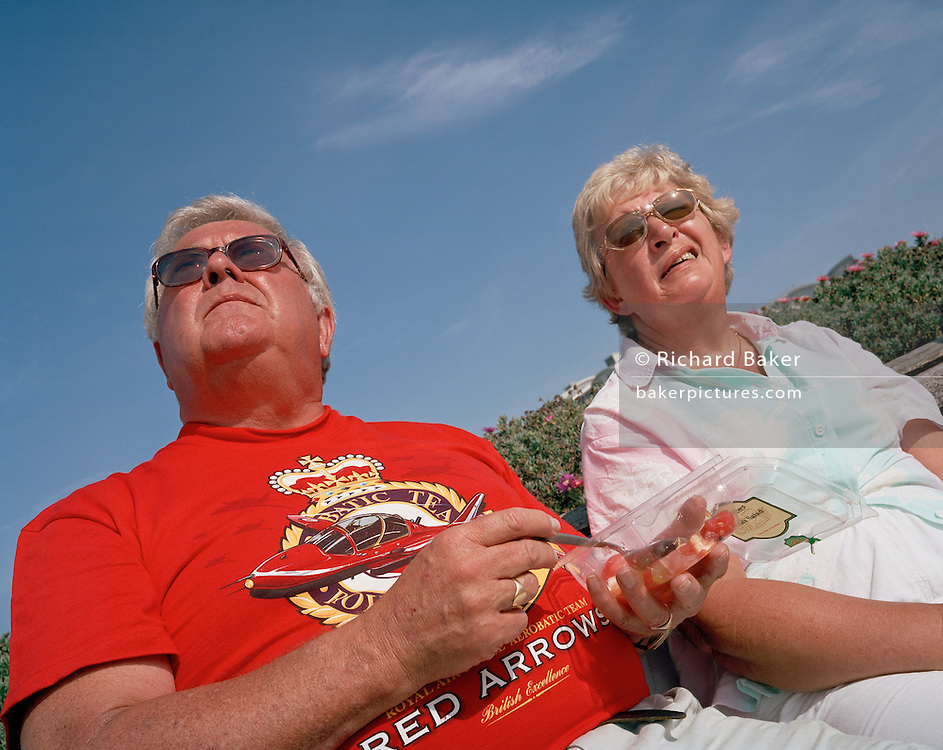 Fans of the 'Red Arrows', Britain's Royal Air Force aerobatic team await their favourite disaplay in Jersey.