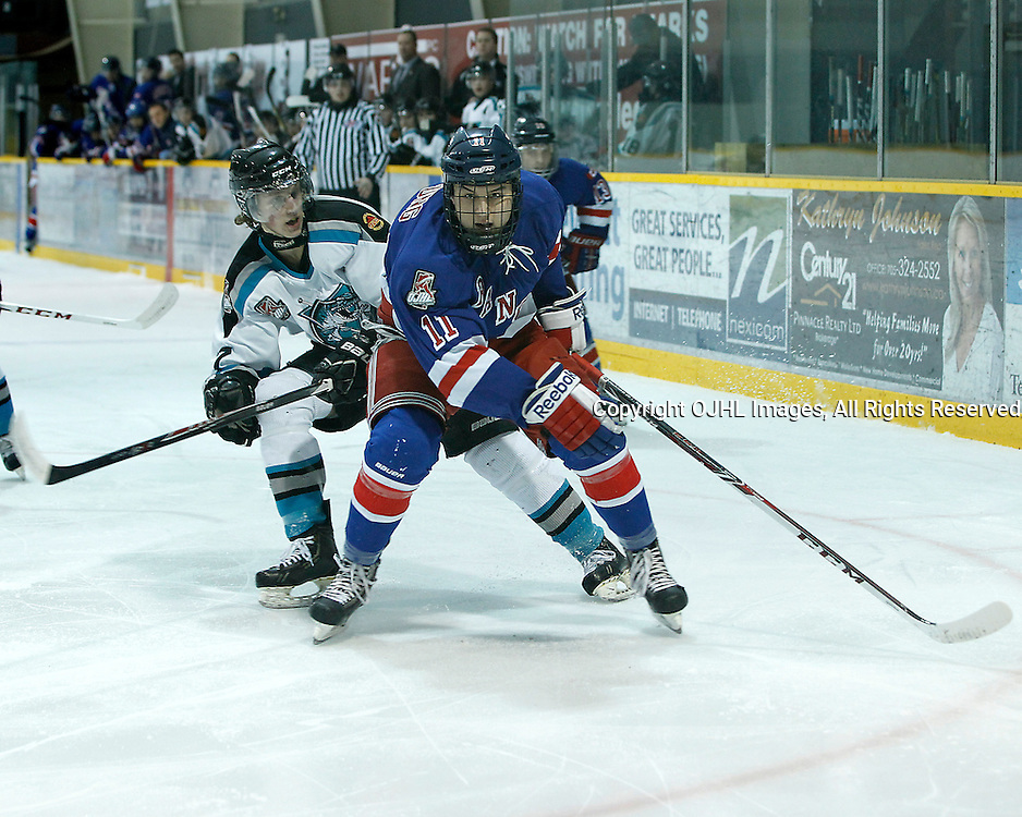 Lindsay, ON - Jan 31 : Ontario Junior Hockey League game action between the Lindsay Muskies and the North York Rangers. James Sterne #7 of the Lindsay Muskies Hockey Club battles for the puck with Zachary Fung #11 of the North York Rangers Hockey Club during first period game action.<br /> (Photo by Tim Bates / OJHL Images)