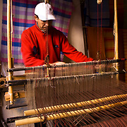A man working with a loom in Marrakech