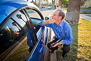 26 OCTOBER 2010 - PHOENIX, AZ: Terry Goddard talks to his wife Monica (in the car) in front of their home in central Phoenix. Goddard lost the election to sitting Governor Jan Brewer, a conservative Republican.     PHOTO BY JACK KURTZ