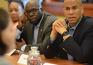 US Senator Cory Booker (D-NJ) (right) speaks with Lisa Askew (left) at South Jersey Family Medical Center Saturday, July 29, 2017 in Burlington, New Jersey. (Photo by William Thomas Cain)