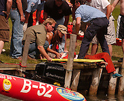 Paramedics and bystanders get ready to move boat racer Julie Venier of LaSalle, Michigan onto a back board prior to being tranported to Northern Michigan Hospital in Petoskey.  Julie and her husband Shane (not pictured) were both injured when they collided with a boat that was tied along the shore during the 2007 Top O' Michigan Marathon Nationals in Indian River.